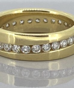 Vintage Diamond Eternity Ring with a stunning sparkly wavy line of diamonds that encircles the ring in a diagonal wave