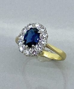 Sapphire and Diamond Cluster Ring, a beautiful natural sapphire surrounded by brilliant cut diamonds. Vintage perfection