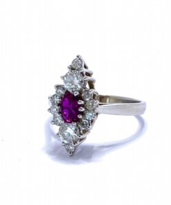 Ruby and Diamond Marquise Cluster Ring, Oval Cut Ruby surrounded by brilliant cut diamonds. Set in 18 carat white gold