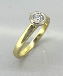 Vintage Diamond Ring has a rub over setting with the brilliant cut solitaire single stone diamond