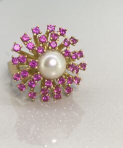 Ruby and Pearl Fancy Cluster Dress Ring in 18 carat Gold. Beautiful bright sparkling rubys with a central cultured pearl.