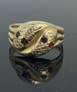 Antique snake ring with garnet eyes in 9ct. Ring size X