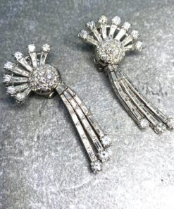 Art Deco Diamond Drop Earrings, fabulous brilliant cut diamonds and baguette diamonds set in platinum. They are 1930's Day and Night Earrings. The bottom baguette set drops can be unclipped, unique and exceptional quality