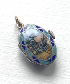 Art Deco Moses Basket Charm, beautifully enamelled moses basket charm with a boy on a camel scene. Inside is a gilt silver 'baby'. Art Deco and in perfect condition