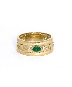 Emerald Set Celtic Style Band in 18ct Gold. Scroll detail surrounding emerald centrepiece.