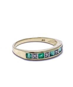 This Antique Emerald Stacking Ring is 9ct and tapers slightly from front to back. The face is rectangular with five alternating flush set glowing Emeralds and four micro Diamonds.