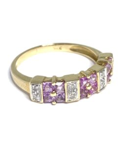 Pink Sapphire Half Eternity Ring with 9ct Gold shaft. Set is 12 pink Amethysts in sets of four and 8 Diamonds all in a rub over setting.