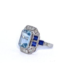 Art Deco 4ct Aquamarine Centrepiece in 18ct White Gold, Embellished With Diamonds and Sapphires.