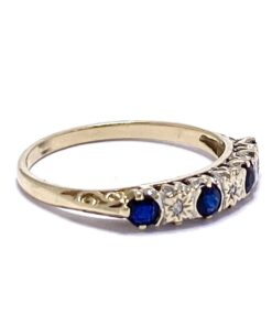 Sapphire and star set Diamond Half Eternity Ring in a rub over setting. The shank is 9ct gold with intricate shoulder scrolling detail