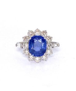 Ceylon Sapphire Cluster Ring With Diamonds in 18ct White Gold. The ring is claw set with a 3ct sapphire approx, surrounded by a carat in total brilliant cut diamonds and two diamond baguettes. A unique, stunning ring.