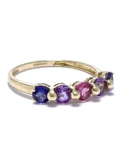 5 Stone Amethyst 9ct half ring. The Amethysts vary in colour from light pink in the centre, to purple and ocean blue. The three central stones are held in place by 2 large ball prongs and the two end stones are held in place with 2 smaller prongs.
