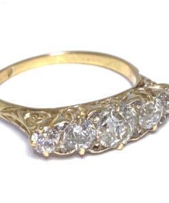 Five Stone transitional cut Diamond Victorian Ring. The shank and basket is 18ct Gold half hoop with rose points between main stones.