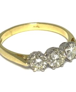 This 3-stone Diamond Ring is set in 18ct white and yellow gold with three brilliant cut, claw set diamonds.