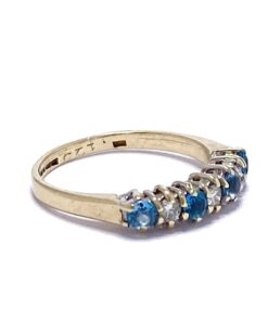 Ocean Blue Topaz and Diamond claw set half eternity ring in 9ct gold.