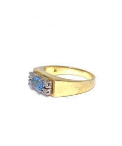 Blue cabochon cut solitaire Aquamarine with diamond accents set in 18ct gold.