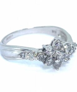Vintage Diamond Cluster Ring, 18ct hallmarked white gold. The diamond cluster is claw set between claw set diamond shoulders. Furthermore, the shoulders display a rib decoration that runs around the slightly twisted shank design. The diamond content is 0.75 cts as marked in the shank.
