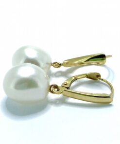 Vintage Pearl Drop Earrings mounted on 14ct stamped gold pierced ear fittings. The pearls measure 9.5 mm X 11.5 mm and are baroque in shape.
