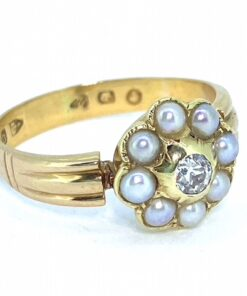 Pearl and Diamond Victorian Daisy Cluster Ring, hallmarked 22ct Chester, 1879. The pearl and central diamond are all rub over set, in a polished shank with ribbed shoulders. The pink tint of the pearl compliments the yellow of the gold beautifully.