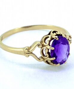 Solitaire Amethyst Gold, hallmarked 9ct. The ring head is a faceted vibrant purple Amethyst, claw set. The mount is embellished with meaningful heart detail and split shank shoulder.