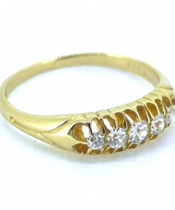 Victorian 5-Stone Diamond Half Hoop Ring, stamped 18ct. The five Victorian cut diamonds are gypsy set in a polished shank with decorative shoulders. The diamonds are a total weight of 0.3 carats and are white in colour. The ring sits perfectly on the finger with a heavy feel.