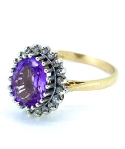 Vintage Amethyst and Diamond oval cluster Ring, Hallmarked 9ct. The Amethyst is claw set and surrounded by claw set faceted diamonds.